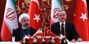 ANKARA, TURKEY - JUNE 9: Turkish Prime Minister Recep Tayyip Erdogan (R) meets with Iranian President Hasan Rouhani (L) at Ankara Palace during business lunch on June 9, 2014 in Ankara, Turkey.)